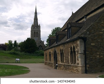 OAKHAM, RUTLAND, UK - JUNE 1 2019: View of the Spire of All Saints Church with the Great Hall of Oakham Castle in the foreground