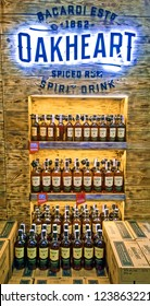 Oakheart spiced rum Bacardi advertisement stand with the glowing logo and 500 ml rum bottles in a supermarket shelf closeup, in Kiev, Ukraine, 22 November 2018.