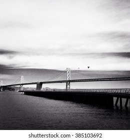 Oakland bay bridge with black and white vintage filter