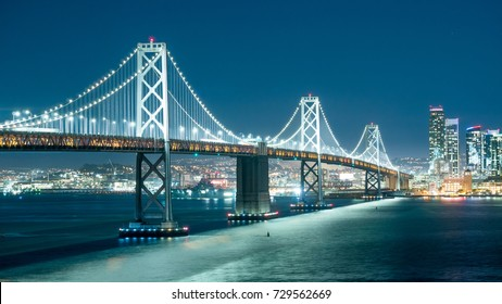 Oakland Bay Bridge and the city light at night.