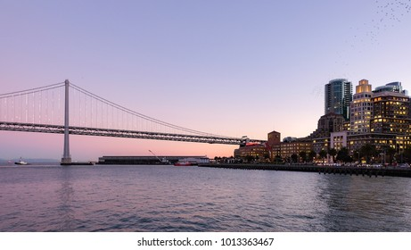 Oakland Bay hanging Bridge in beautiful purple sunset connecting San Francisco and Oakland.