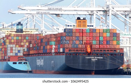 Oakland, CA - April 02, 2018: Cargo Ship YANTIAN EXPRESS loading at the Port of Oakland, the fifth busiest port in the United States.