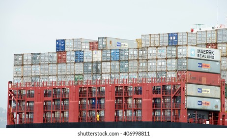 Oakland, CA - April 08, 2016:Rows of stacked shipping containers aboard MSC BRUNELLA at the Port of Oakland. Most modern container ships can carry up to 16,020 twenty-foot equivalent units.