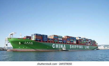 OAKLAND, CA - APRIL 12, 2015: China Shipping Line Cargo Ship CSCL AUTUMN departing the Port of Oakland. The Port of Oakland is the fifth busiest container port in the United States.