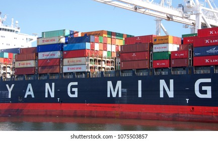 Oakland, CA - April 14, 2018: YM UNISON loading at the Port of Oakland. Yang Ming Marine Transport Corp provides shipping to over 70 nations with more than 170 service points.