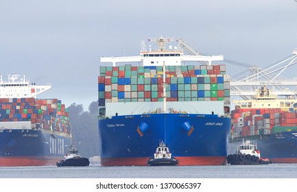 Oakland, CA - April 14, 2019: Cargo Ship COSCO SPAIN departing the Port of Oakland as CMA CGM A. LINCOLN maneuvers into the Port of Oakland, the fifth busiest port in the United States.