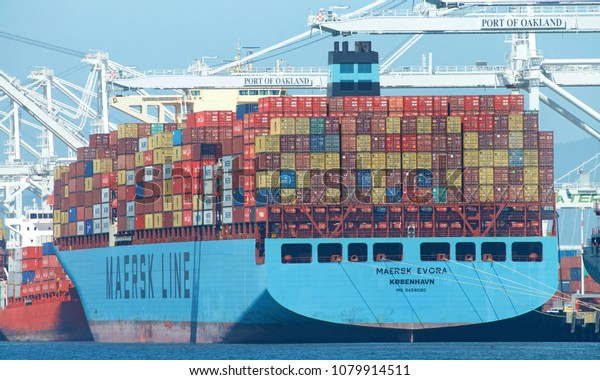 Oakland, CA - April 20, 2018: Cargo Ship MAERSK EVORA loading at the Port of Oakland. Maersk has been the largest container ship operator and supply vessel operator in the world since 1996.