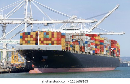 Oakland, CA - August 11, 2018: Cargo Ship MAERSK EUREKA loading at the Port of Oakland. Maersk is the worlds largest container shipping company having customers through 374 offices in 116 countries.