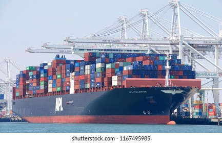 Oakland, CA - August 19, 2018: Cargo Ship APL FULLERTON loading at the Port of Oakland. American President Lines(APL)is the worlds 7th largest container transportation and shipping company.