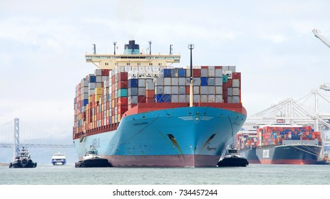 Oakland, CA - August 21, 2017: Multiple tugboats assist cargo ship GJERTRUD MAERSK to maneuver into the Port of Oakland, the fifth busiest port in the United States