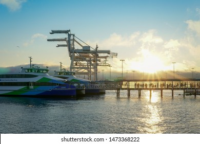 OAKLAND, CA - AUGUST 3, 2019:  Passengers line up to board the San Francisco Bay Ferry at the Oakland Jack London Square Ferry Terminal in Oakland California.