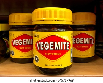 Oakland, CA - December 02, 2016: Grocery store shelf with jars of Vegemite brand Yeast Extract, a thick black Australian food spread made from leftover brewers yeast extract with vegetables and spice