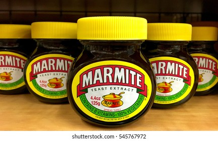 Oakland, CA - December 02, 2016: Grocery store shelf with jars of Marmite brand Yeast Extract. A by-product of beer brewing, enjoyed at any time on toast for breakfast, in sandwiches at lunchtime
