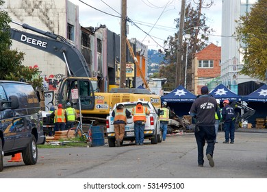 """Oakland, CA - December 06, 2016: Recovery efforts continue in the aftermath of the """"Ghost Ship"""" warehouse fire in Oakland, CA. Death toll currently at 36 people."""