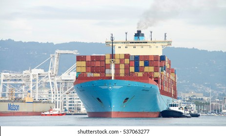 Oakland, CA - December 13, 2016: Cargo Ship GERD MAERSK entering the Port of Oakland, the busiest port in the United States.