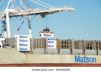 Oakland, CA - December 28, 2016: Matson cargo ship MAUI unloading at the Port of Oakland. Crane operators can move an average of 30 containers per hour on or off the ships.