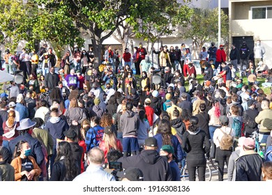 Oakland, CA - Feb 13, 2021: Unidentified participants at the Love Our People Heal Our Communities vigil in China Town. Organized to be united to condemn harm against Asian elders, women and youth.