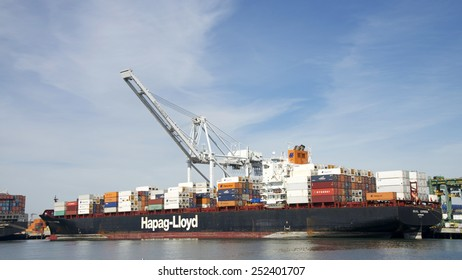 OAKLAND, CA - FEBRUARY 12, 2015: Hapag-Lloyd Cargo Ship SEOUL EXPRESS Loading at the Port of Oakland.The Port of Oakland's cargo volume makes it the fifth busiest container port in the United States.