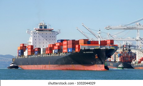 Oakland, CA - February 21, 2018: Cargo Ship ANL WARRAGUL entering the Port of Oakland. The cargo volume at the  Port of Oakland makes it the fifth busiest container port in the U.S.