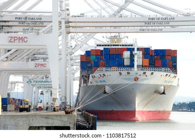 Oakland, CA - January 02, 2016: Cargo Ship OOCL BEIJING loading at the Port of Oakland, the fifth busiest port in the United States.