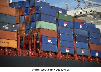 OAKLAND, CA - JANUARY 10, 2015: Rows of stacked shipping containers aboard APL Cargo Ship at the Port of Oakland. Most modern container ships can carry up to 16,020 twenty-foot equivalent units.
