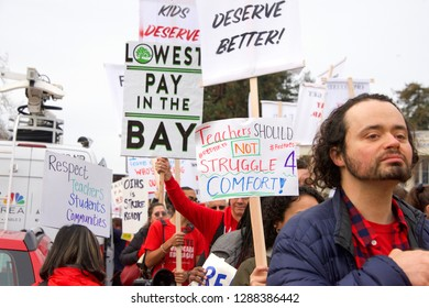 "Oakland, CA - January 18, 2019: Oakland teachers having a one day ""sick out"" to protest slow progress on contract talks with the district. Fighting for smaller class sizes and bigger paychecks."