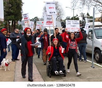 """Oakland, CA - January 18, 2019: Oakland teachers having a one day """"sick out"""" to protest slow progress on contract talks with the district. Fighting for smaller class sizes and bigger paychecks."""