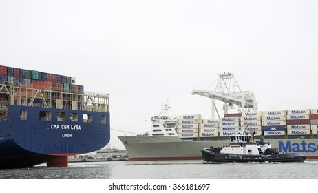 OAKLAND, CA - JANUARY 20, 2016: Tugboat AHBRA FRANCO at the stern of CMA CGM LYRA, assisting the vessel to maneuver through the heavy fog to the Port of Oakland.