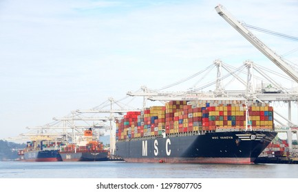 Oakland, CA - January 28, 2019: Cargo Ships loading at the Port of Oakland. The Port of Oakland loads and discharges more then 99 percent of containerized goods moving through Northern California.