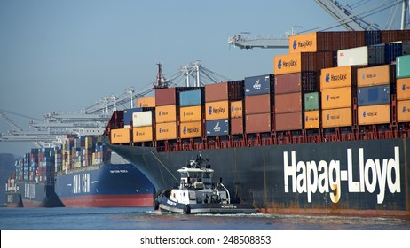 OAKLAND, CA - JANUARY 30, 2015:  Hapag-Lloyd Cargo Ship BOSTON EXPRESS entering the Port of Oakland with Tugboat Assist. Tugboats are vital for safe, efficient entry and exit for the large ships.