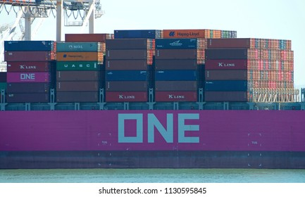 Oakland, CA - July 09, 2018: Cargo Ship ONE COMPETENCE loading at the Port of Oakland. Ocean Network Express recently acquired NYK, K Line and MOL shipping companies.