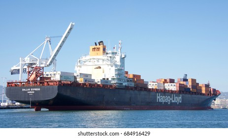 Oakland, CA - July 10, 2017: Hapag-Lloyd Cargo ship DALLAS EXPRESS departing the Port of Oakland, the fifth busies port in the United States.