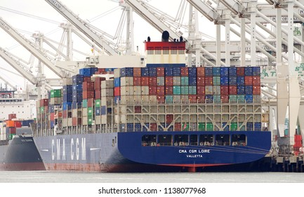 Oakland, CA - July 16, 2018: Cargo Ship CMA CGM LOIRE loading at the Port of Oakland. Compagnie Generale Maritime (CMA CGM) is the third largest shipping company in the world.