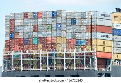 Oakland, CA - July 18, 2016: Shipping containers are organized and placed algorithmically for efficient transport. Most modern container ships can carry up to 16,020 twenty-foot equivalent units.