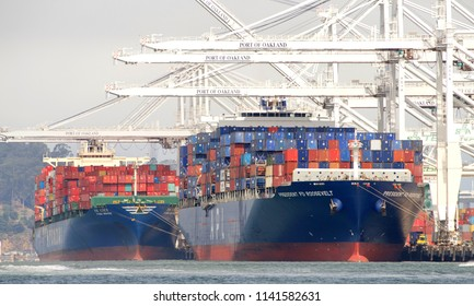Oakland, CA - July 22, 2018: Cargo Ships HYUNDAI SINGAPORE and PRESIDENT FD ROOSEVELT loading at the Port of Oakland, the fifth busiest port in the United States.
