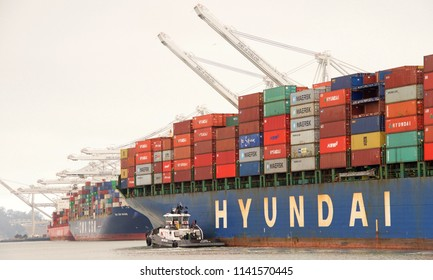 Oakland, CA - July 23, 2018: HYUNDAI SINGAPORE departing the Port of Oakland. Hyundai Merchant Marineis the is the world's 15th largest container line in terms of vessel capacity.