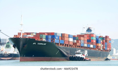 Oakland, CA - July 27, 2016: Cargo Ship APL TOURMALINE with tugboats assisting the vessel to maneuver into the Port of Oakland.