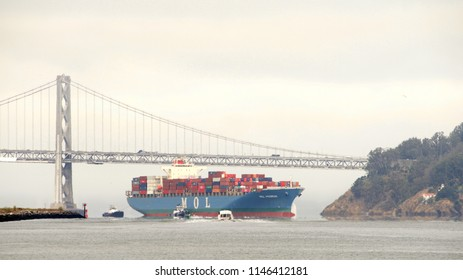 Oakland, CA - July 30, 2018: Cargo Ship MOL PREMIUM entering the Port of Oakland, the fifth busiest port in the United States.