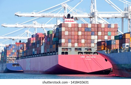 Oakland, CA - June 06, 2019: Cargo Ship ONE ARCADIA loading at the Port of Oakland. Ocean Network Express is a joint venture between Nippon Yusen Kaisha , Mitsui O.S.K. Lines and K Line.