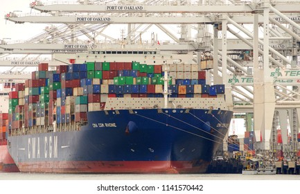 Oakland, CA - June 23, 2018: Cargo Ship CMA RHONE loading at the Port of Oakland. Compagnie Generale Maritime (CMA CGM) is the third largest shipping company in the world.