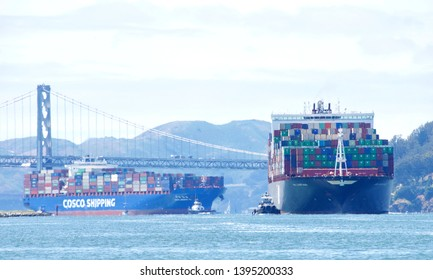 Oakland, CA - May 07, 2019: Cargo Ships APL SANTIAGO and CSCL BOHAI SEA entering the Port of Oakland, one right after the other. Port of Oakland is the 5th busiest port in the U.S.