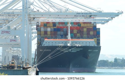 Oakland, CA - May 17, 2018: Cargo Ship MSC LAUREN loading at the Port of Oakland, the fifth busiest port in the United States.