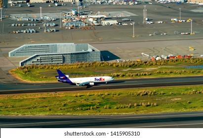 OAKLAND, CA - MAY 1st 2019: A FedEx airplane departs Oakland International Aiport