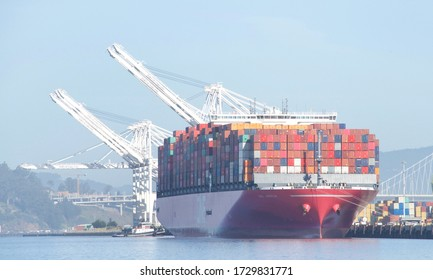 Oakland, CA - May 7, 2020: Cargo Ship ONE AQUILA loading at the Port of Oakland. Ocean Network Express is a joint venture between Nippon Yusen Kaisha , Mitsui O.S.K. Lines and K Line.