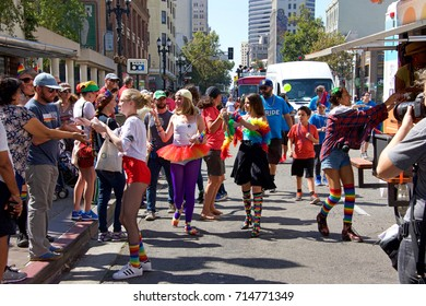 Oakland, CA - September 10, 2017: Unidentified participants celebrate at the Oakland Gay Pride Festival and Parade on Broadway, downtown Oakland. This years theme, We Rise Oakland Pride.