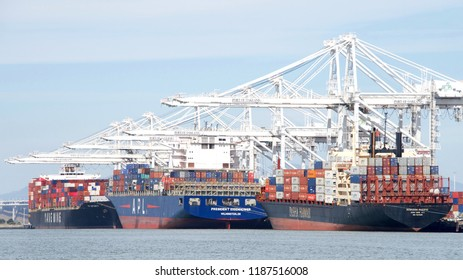 Oakland, CA - September 12, 2018: Cargo Ships loading at the Port of Oakland, which loads and discharges more then 99 percent of containerized goods moving through Northern California