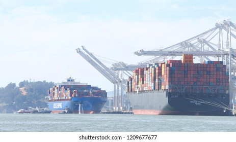 Oakland, CA - September 14, 2018: Multiple tugboats assisting Cargo ship CSCL WINTER to maneuver to the dock at the Port of Oakland, the fifth busiest port in the U.S.