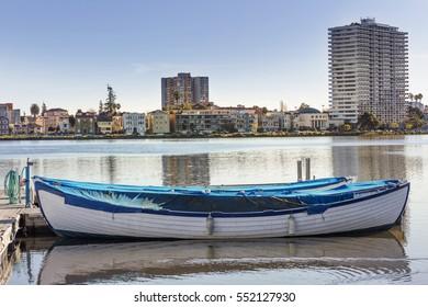 Oakland, California Adams Point and Lake Merritt Lakeshore with boat.