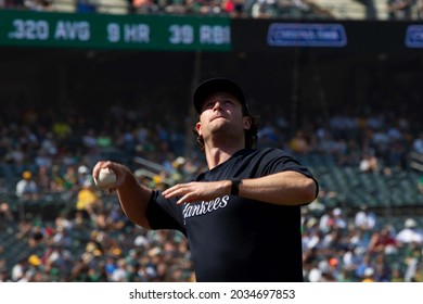 Oakland, California - August 28, 2021: New York Yankees' Gerrit Cole throws a foul ball over the net into the stands during a game against Oakland Athletics at RingCentral Coliseum.