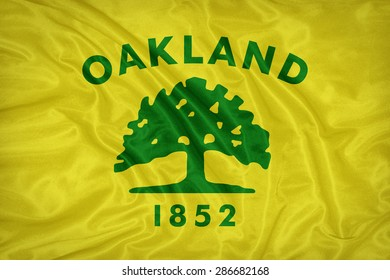 Oakland ,California flag on fabric texture,retro vintage style